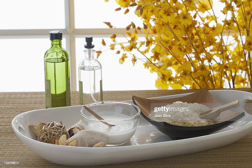 Bath salt, coconut milk and bottles at spa : Stock Photo