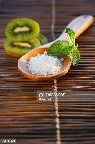 Bath salt on wooden spoon