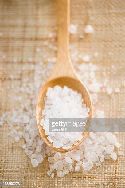 Bath salts on wooden spoon