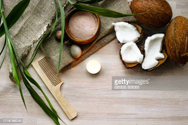 bath, spa concept, salt, coconut, lighting candle, linen towel, haircomb on wooden background - coconut stock pictures, royalty-free photos & images