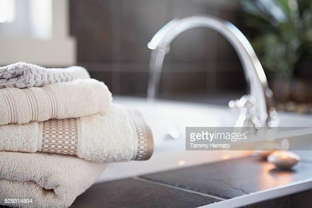 Bath towels near bathtub