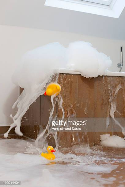 bath tub overflowing - overflowing stock pictures, royalty-free photos & images