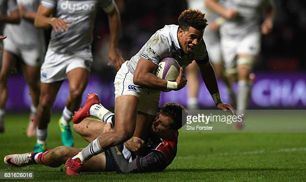 Bath wing Anthony Watson breaks the tackle of Jack Wallace during the European Rugby Challenge Cup match between Bristol Rugby and Bath Rugby at...