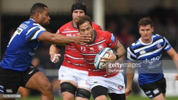 Bath wing Joe Cokanasiga grabs Gloucester player Danny Cipriani during the Gallagher Premiership Rugby match between Bath Rugby and Gloucester Rugby...