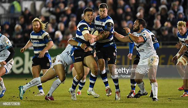 Bath wing Matt Banahan and Sam Burgess charge through the Montpellier centre during the European Rugby Champions Cup pool match between Bath Rugby...
