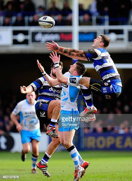 Bath wing Matt Banahan outjumps Finn Russell of Glasgow during the European Rugby Champions Cup match between Bath Rugby and Glasgow Warriors at...