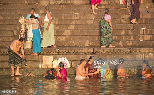 bathe in the sacred waters, varanasi, india - pilgrims and indians stock photos and pictures