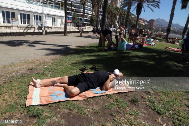 Bathers and tourists enjoy a day on the beach of La Malagueta, where today in the news the UK reported it is keeping Spain on the amber list and not...