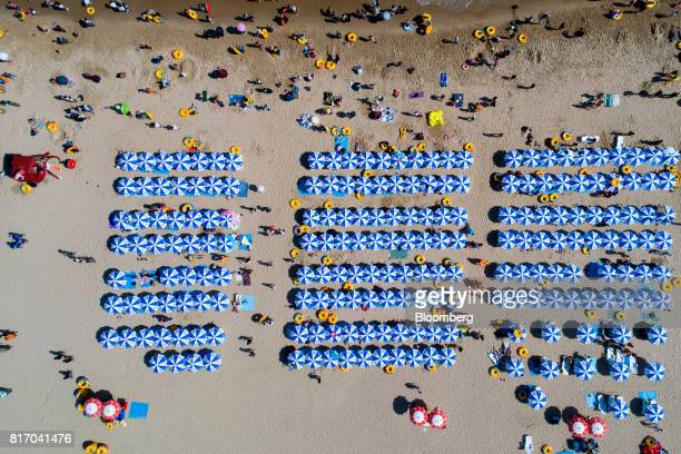 Bathers are seen on the beach in this aerial photograph taken above Haeundae beach in Busan South Korea on Sunday July 16 2017 South Korea's minimum...