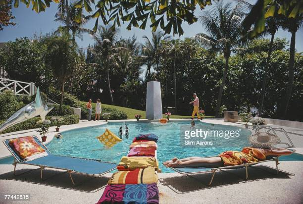 Bathers around the pool at 'Four Winds' the home of J Patrick Lannan in Palm Beach Florida April 1968