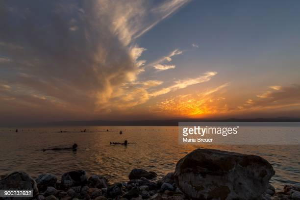Bathers at sunset with clouds, Sowayma, Dead Sea, Jordan