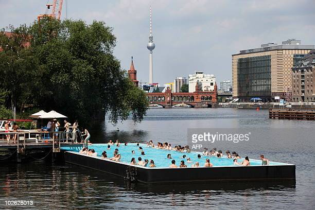 Bathers cool off in the pool of the 'Badeschiff' placed on the river Spree in Berlin on July 5 2010 Temperatures of around 30 degrees centigrade are...