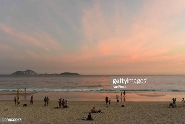 Bathers crowd on Ipanema beach, Rio de Janeiro, Brazil, on July 8, 2020 and ignore the danger of the corona virus pandemic, with 10,900 deaths and...