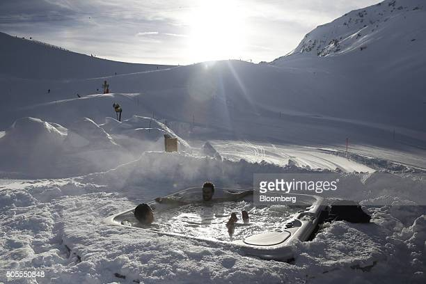 Bathers enjoy an outside jacuzzi spa at the igloo hotel operated by IgluDorf GmbH on the Parsenn mountain in Davos Switzerland on Monday Jan 18 2015...