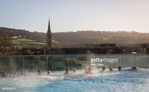 Bathers enjoy naturally warmed spa water as they relax in the rooftop pool of the Thermae Bath Spa Britain's only natural thermal spa on December 23...