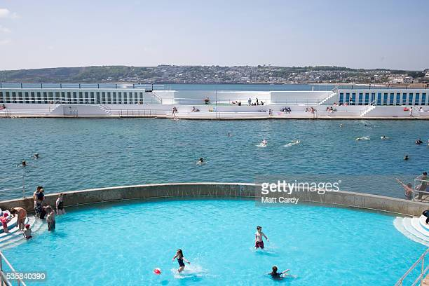 Bathers enjoy the fine weather at the recently reopened Jubilee Pool lido in Penzance on May 30, 2016 in Cornwall, England. The Grade II Listed Art...