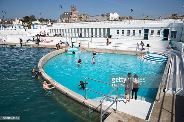 Bathers enjoy the fine weather at the recently reopened Jubilee Pool lido in Penzance on May 30 2016 in Cornwall England The Grade II Listed Art Deco...