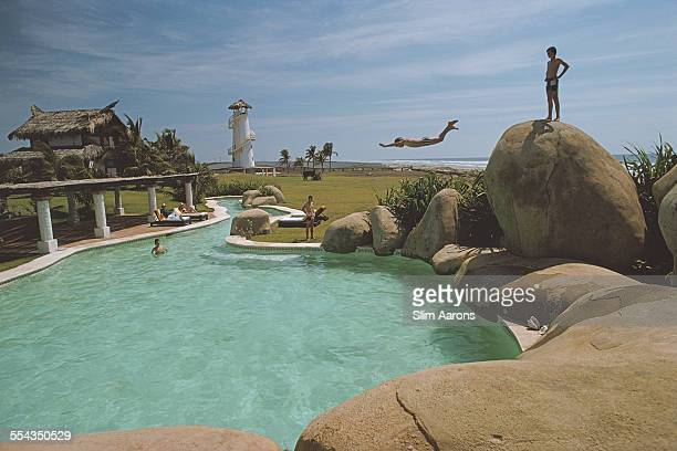 Bathers enjoy the pool at Manuel Perusquia Jr's 'Little Beach House' villa in Acapulco Mexico February 1975