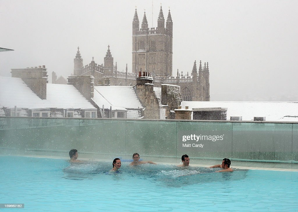 Bathers enjoy the rooftop pool at the Thermae Bath Spa as the snow continues to fall on January 18, 2013 in Bath, England. Heavy snow is bringing widespread disruption to many parts of the UK.