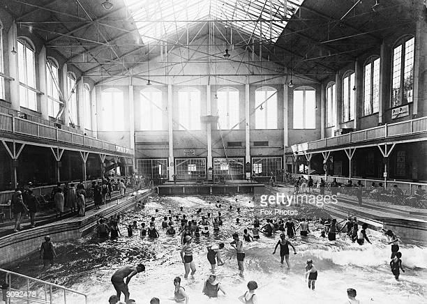 Bathers enjoy themselves at a German indoor swimming pool