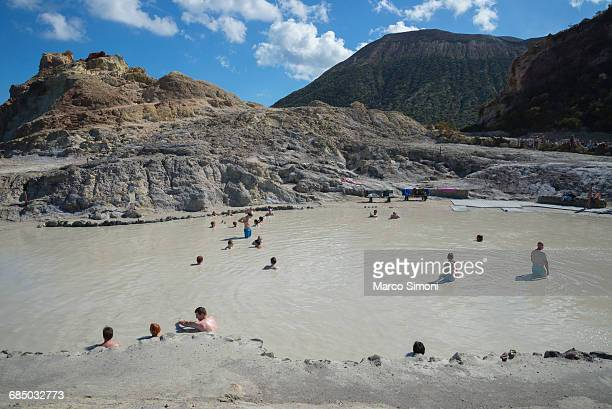 Bathers enjoying the therapeutic benefits of the volcanic mud in the hot spring pool, Vulcano Island, Aeolian Islands, UNESCO World Heritage Site, Sicily, Italy, Mediterranean, Europe