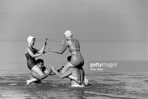 Bathers frolic in the sea off Long Island New York From black and white book