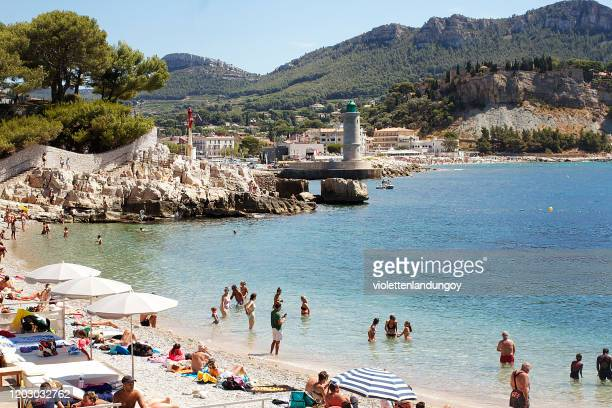 bathers on cassis beach in france - cassis stock pictures, royalty-free photos & images
