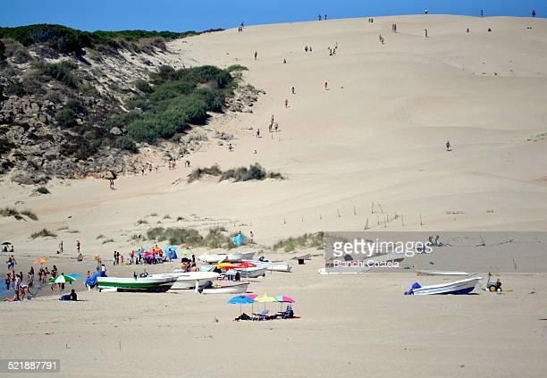 Bathers on the sand dunes in Tarifa