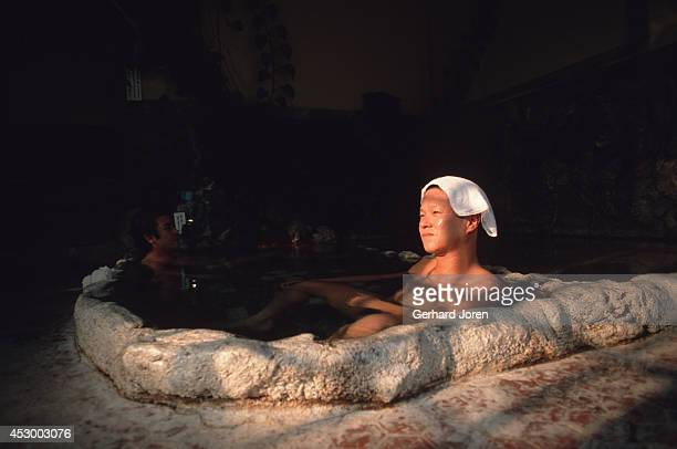 Bathers relax at an onsen in Beppu. Synonymous with Buddhism, bathing is a means of purification. Hot springs in Japan vary greatly. Some are rich in...