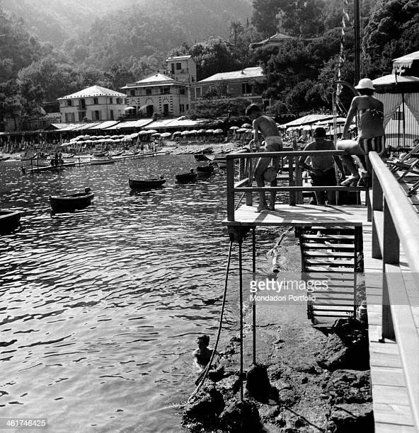 Bathers relaxing at the exclusive lido Paraggi on the riviera of Liguria Paraggi 1960s