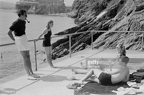 Bathers relaxing on a sun deck by the sea outside the Grand Hotel in Torquay, August 1947. Original publication: Picture Post - 4418 - Grand Hotel -...