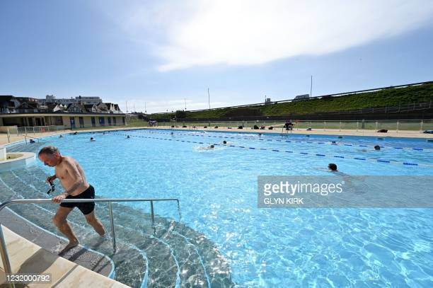 Bathers swim in Saltdean Lido near Brighton as England's third Covid-19 lockdown restrictions ease, allowing outdoor sports facilities to open on...
