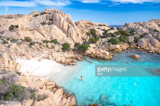 bathing at a secluded beach, sardinia, italy - sardinia stock pictures, royalty-free photos & images