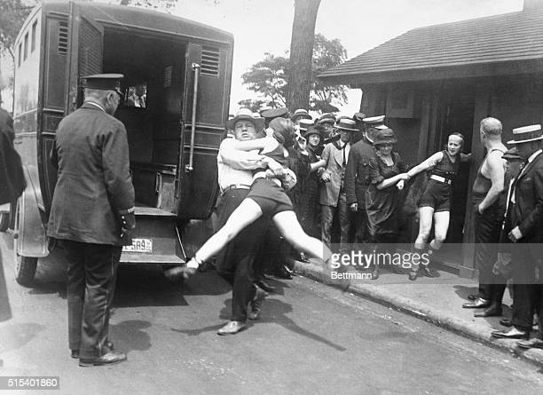 Bathing beauties being arrested for defying a Chicago edict banning abbreviated bathing suits on beaches