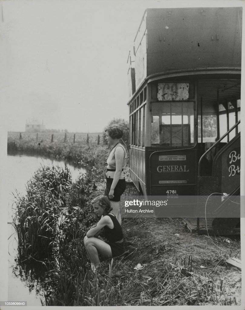 Bathing From An Old Bus : News Photo