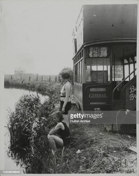 Bathing From An Old Bus The Urban District Council of Sandy Bedforshire has provided a second hand LGOC bus body for the use of women bathers in a...