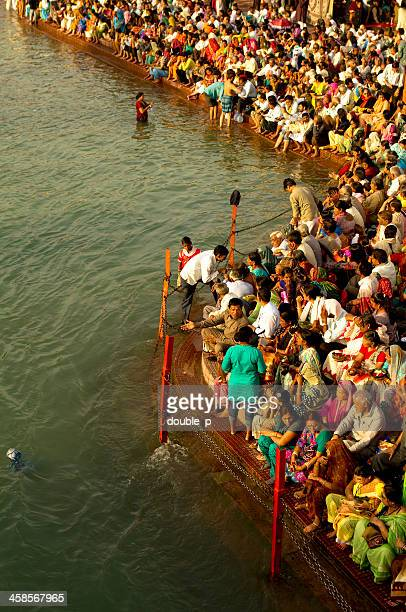 bathing in ganges river - kumbh mela stock pictures, royalty-free photos & images