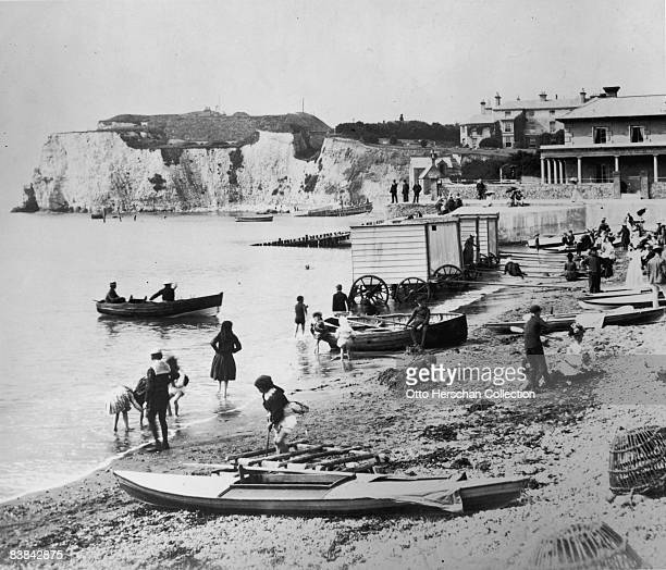 Bathing machines on the beach at Freshwater Bay on the Isle of Wight, circa 1887.