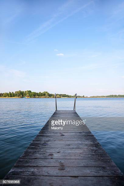 Bathing Pier. Jetty. View Of Lake Chiemsee Next To Wooden Jetty