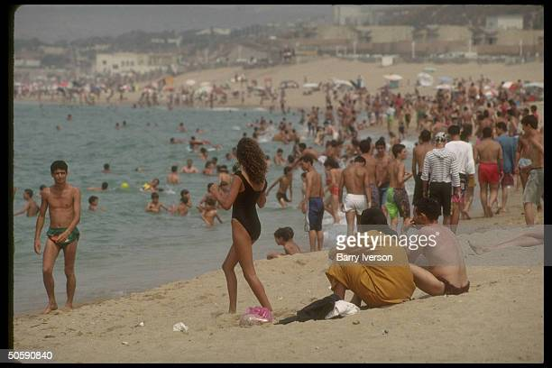Bathingsuit brazen men women crowding Club des Pins beach no longer intimidated by Moslem fundamentalist pressure which emptied beaches for yr