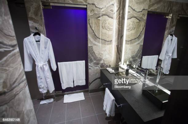 A bathrobe is hung on display inside the changing room at the Spa by Ivanka Trump during the grand opening of Trump International Hotel Tower in...