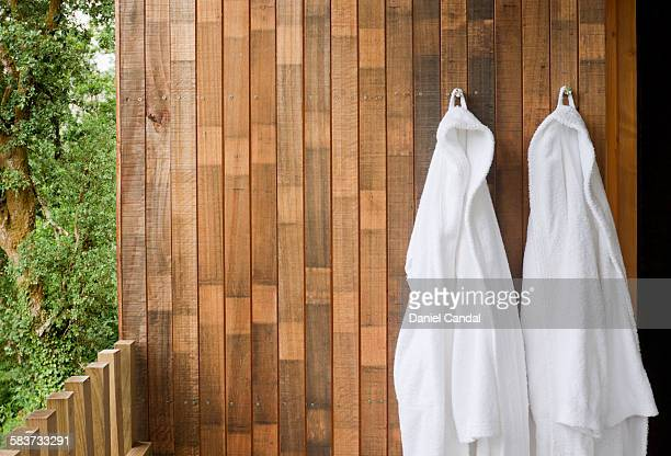 Bathrobes hanging on a wall