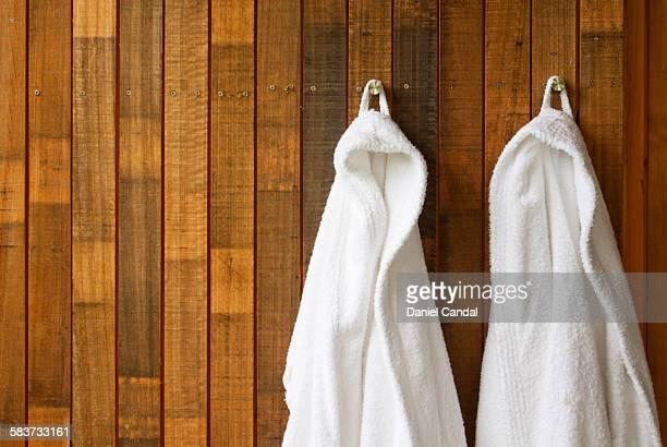 Bathrobes hanging on wall