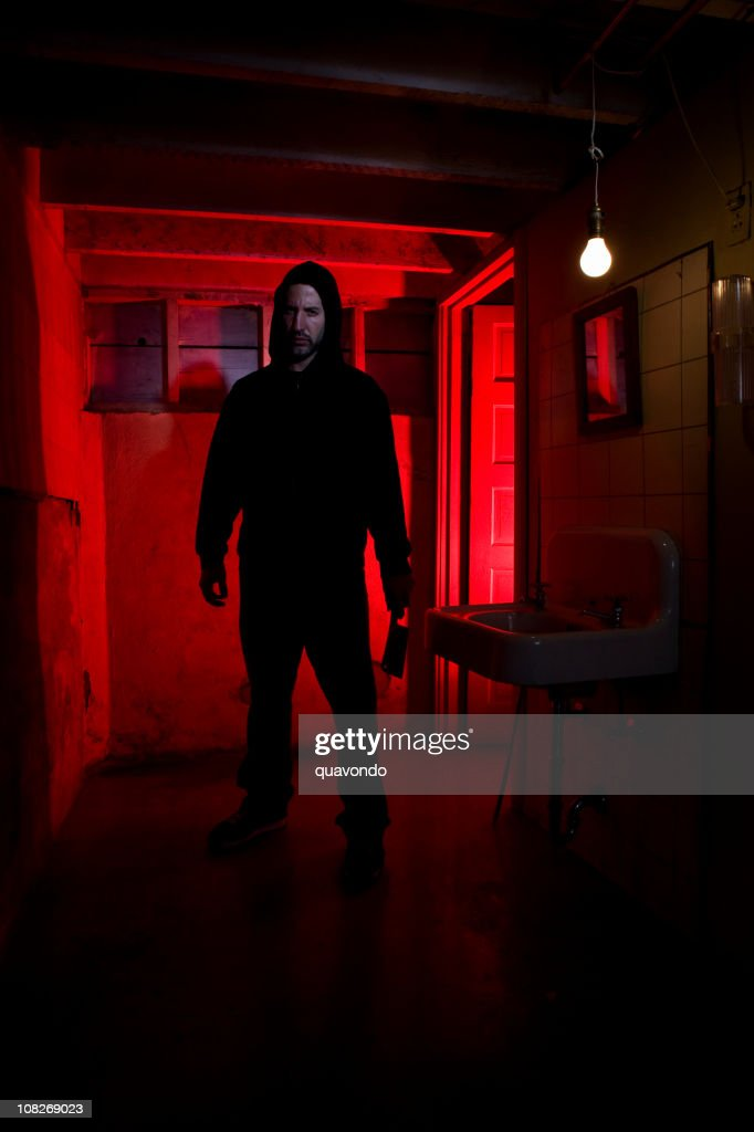 Bathroom Basement with Scary Killer Holding Knife, Copy Space : Stock Photo