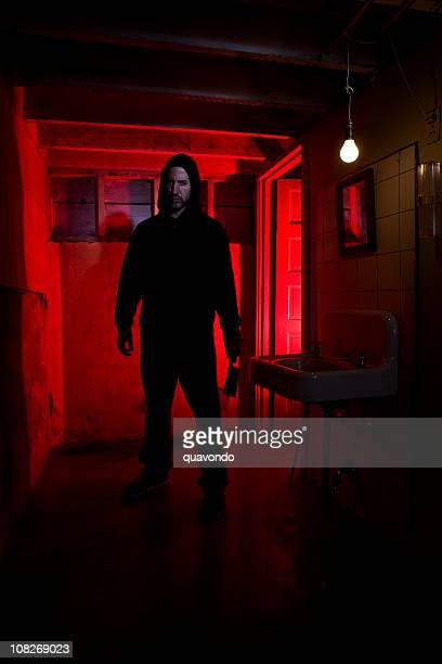 bathroom basement with scary killer holding knife, copy space - stalker person stock photos and pictures