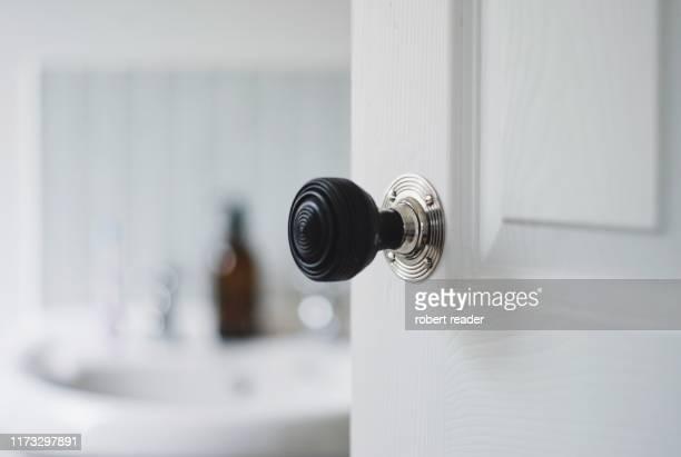 bathroom door handle - türrahmen stock-fotos und bilder