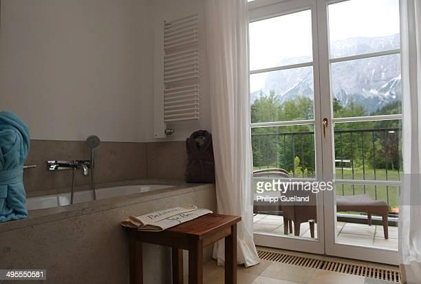 Bathroom is seen in a suite at Schloss Elmau, a luxury spa hotel, in the Bavarian Alps of southern Germany on June 3, 2014 in Kruen near...