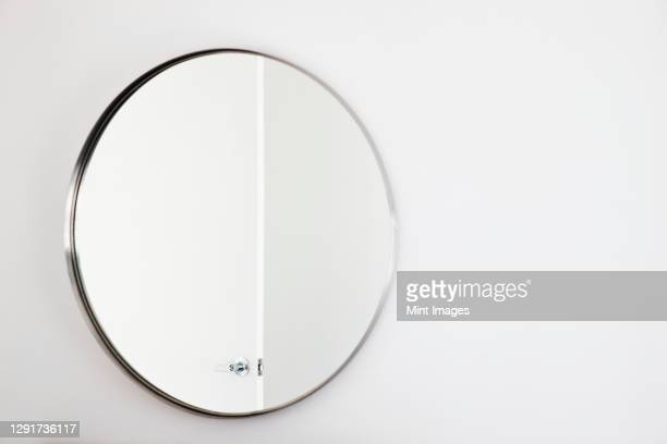 bathroom mirror on a white wall. - china: through the looking glass stock pictures, royalty-free photos & images