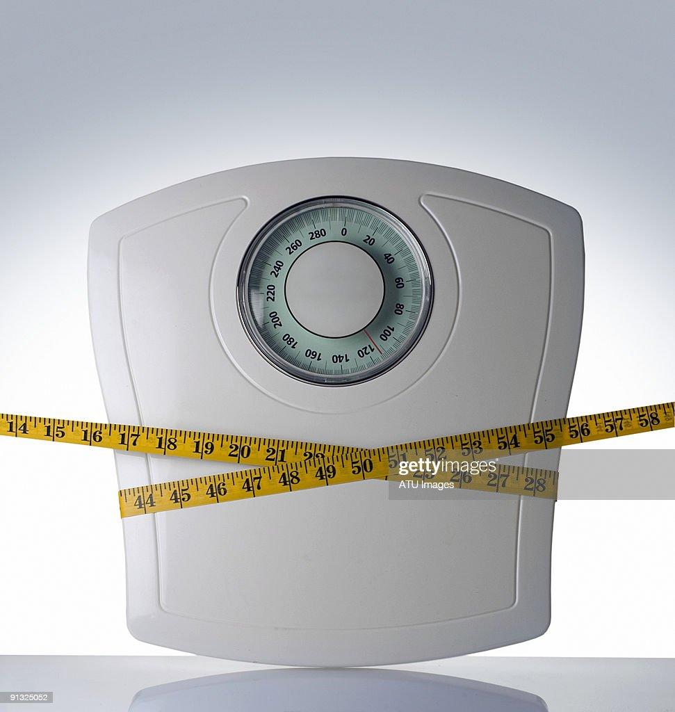 bathroom scale tape measure : Stock Photo