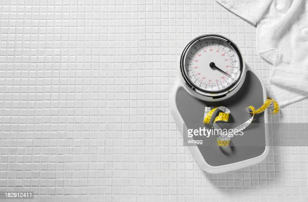 bathroom scales and tape measure - mass unit of measurement stock pictures, royalty-free photos & images